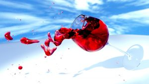 wine glass tipping over and spilling
